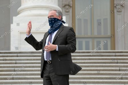 United States Senator Tim Kaine (Democrat of Virginia) speaks to United States Senator Thom Tillis (Republican of North Carolina), not pictured, as he enters the United States Capitol in Washington D.C., U.S..