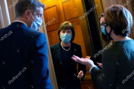 Stock Image of United States Senator Susan Collins (Republican of Maine) speaks to members of the media as she leaves the United States Capitol in Washington D.C., U.S..