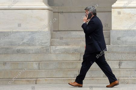 United States Senator Cory Gardner (Republican of Colorado) speaks on the phone as he leaves the United States Capitol in Washington D.C., U.S..