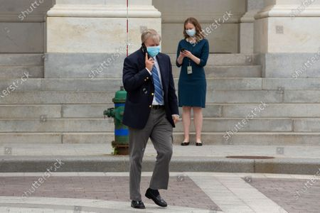 United States Senator Lindsey Graham (Republican of South Carolina) speaks on the phone as he leaves the United States Capitol in Washington D.C., U.S..