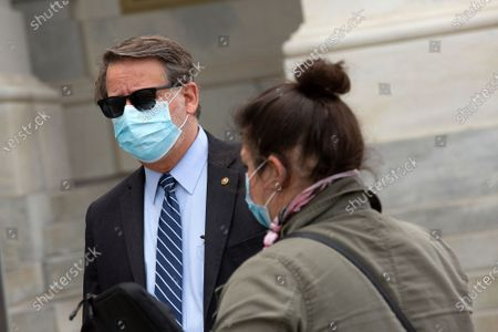 United States Senator Gary Peters (Democrat of Michigan) speaks to a reporter as he leaves the United States Capitol in Washington D.C., U.S..