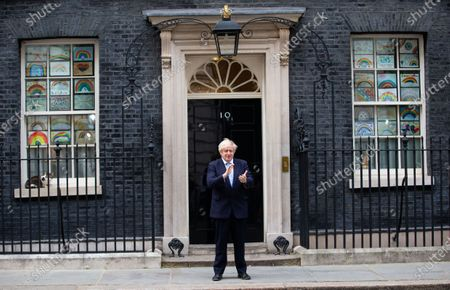 Prime Minister Boris Johnson takes part in the Clap for our Carers at No.10 Downing Street, London.