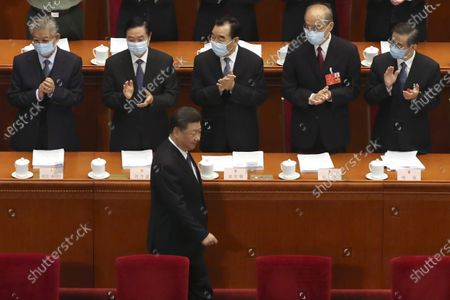 Delegates applaud as Chinese President Xi Jinping arrives for the opening session of China's National People's Congress (NPC) at the Great Hall of the People in Beijing
