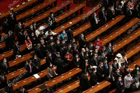 Delegates leave after the opening session of China's National People's Congress (NPC) at the Great Hall of the People in Beijing