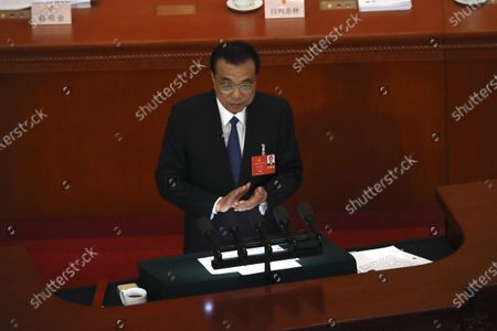 Chinese Premier Li Keqiang delivers the government work report during the opening session of China's National People's Congress (NPC) at the Great Hall of the People in Beijing