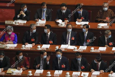 Delegates gather before the start of the opening session of China's National People's Congress (NPC) at the Great Hall of the People in Beijing