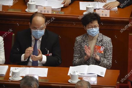 Hong Kong Chief Executive Carrie Lam, right, attends the opening session of China's National People's Congress (NPC) at the Great Hall of the People in Beijing