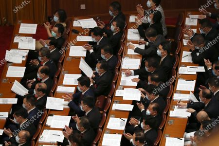 Delegates applaud during the opening session of China's National People's Congress (NPC) at the Great Hall of the People in Beijing, China, 22 May 2020. China held the Chinese People's Political Consultative Conference (CPPCC) on 21 May and will hold the National People's Congress (NPC) on 22 May, after the two major political meetings initially planned to be held in March 2020 were postponed amid the ongoing coronavirus COVID-19 pandemic.