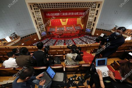 Journalists wearing face masks cover the opening session of China's National People's Congress (NPC) at the Great Hall of the People in Beijing, China, 22 May 2020. China held the Chinese People's Political Consultative Conference (CPPCC) on 21 May and will hold the National People's Congress (NPC) on 22 May, after the two major political meetings initially planned to be held in March 2020 were postponed amid the ongoing coronavirus COVID-19 pandemic.