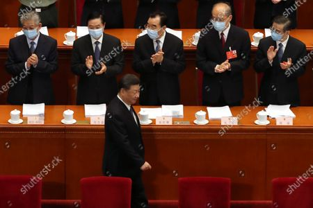 Delegates applaud as Chinese President Xi Jinping (C, bottom) arrives for the opening session of China's National People's Congress (NPC) at the Great Hall of the People in Beijing, China, 22 May 2020. China held the Chinese People's Political Consultative Conference (CPPCC) on 21 May and will hold the National People's Congress (NPC) on 22 May, after the two major political meetings initially planned to be held in March 2020 were postponed amid the ongoing coronavirus COVID-19 pandemic.