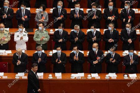 Delegates applaud as Chinese President Xi Jinping (L, bottom) arrives for the opening session of China's National People's Congress (NPC) at the Great Hall of the People in Beijing, China, 22 May 2020. China held the Chinese People's Political Consultative Conference (CPPCC) on 21 May and will hold the National People's Congress (NPC) on 22 May, after the two major political meetings initially planned to be held in March 2020 were postponed amid the ongoing coronavirus COVID-19 pandemic.