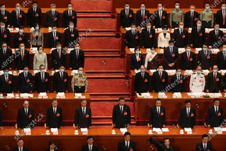 Chinese President Xi Jinping (C) and other Chinese leaders stand during the opening session of China's National People's Congress (NPC) at the Great Hall of the People in Beijing, China, 22 May 2020. China held the Chinese People's Political Consultative Conference (CPPCC) on 21 May and will hold the National People's Congress (NPC) on 22 May, after the two major political meetings initially planned to be held in March 2020 were postponed amid the ongoing coronavirus COVID-19 pandemic.