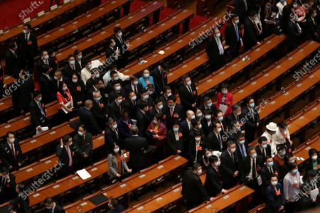 Delegates leave after the opening session of China's National People's Congress (NPC) at the Great Hall of the People in Beijing, China, 22 May 2020. China held the Chinese People's Political Consultative Conference (CPPCC) on 21 May and will hold the National People's Congress (NPC) on 22 May, after the two major political meetings initially planned to be held in March 2020 were postponed amid the ongoing coronavirus COVID-19 pandemic.