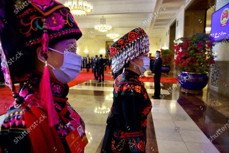 Delegates in ethnic minority dress arrive before the opening session of China's National People's Congress (NPC) at the Great Hall of the People in Beijing, China, 22 May 2020. China held the Chinese People's Political Consultative Conference (CPPCC) on 21 May and will hold the National People's Congress (NPC) on 22 May, after the two major political meetings initially planned to be held in March 2020 were postponed amid the ongoing coronavirus COVID-19 pandemic.