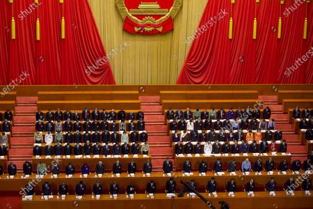 Chinese leaders and delegates bow their heads during the opening session of China's National People's Congress (NPC) at the Great Hall of the People in Beijing, China, 22 May 2020. China held the Chinese People's Political Consultative Conference (CPPCC) on 21 May and will hold the National People's Congress (NPC) on 22 May, after the two major political meetings initially planned to be held in March 2020 were postponed amid the ongoing coronavirus COVID-19 pandemic.