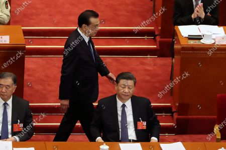 Chinese Premier Li Keqiang (C) walks past President Xi Jinping (R) during the opening session of China's National People's Congress (NPC) at the Great Hall of the People in Beijing, China, 22 May 2020. China held the Chinese People's Political Consultative Conference (CPPCC) on 21 May and will hold the National People's Congress (NPC) on 22 May, after the two major political meetings initially planned to be held in March 2020 were postponed amid the ongoing coronavirus COVID-19 pandemic.