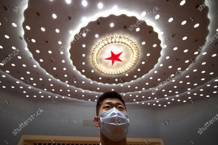 A Chinese security official stands guard after the opening session of China's National People's Congress (NPC) at the Great Hall of the People in Beijing, China, 22 May 2020. China held the Chinese People's Political Consultative Conference (CPPCC) on 21 May and will hold the National People's Congress (NPC) on 22 May, after the two major political meetings initially planned to be held in March 2020 were postponed amid the ongoing coronavirus COVID-19 pandemic.