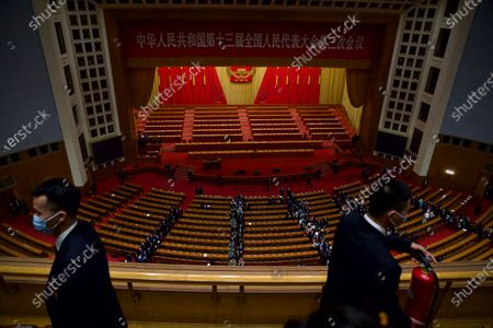 Chinese security officials stand guard after the opening session of China's National People's Congress (NPC) at the Great Hall of the People in Beijing, China, 22 May 2020. China held the Chinese People's Political Consultative Conference (CPPCC) on 21 May and will hold the National People's Congress (NPC) on 22 May, after the two major political meetings initially planned to be held in March 2020 were postponed amid the ongoing coronavirus COVID-19 pandemic.