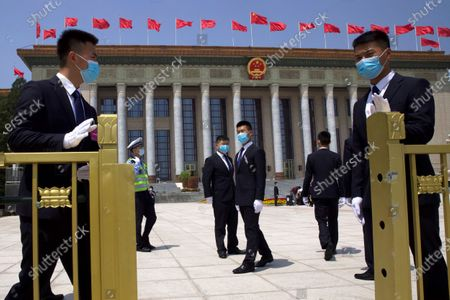 Chinese security officials wear face masks as they stand guard outside the Great Hall of the People after the opening session of China's National People's Congress (NPC) at the Great Hall of the People in Beijing, China, 22 May 2020. China held the Chinese People's Political Consultative Conference (CPPCC) on 21 May and will hold the National People's Congress (NPC) on 22 May, after the two major political meetings initially planned to be held in March 2020 were postponed amid the ongoing coronavirus COVID-19 pandemic.