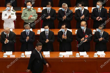 Delegates applaud as Chinese President Xi Jinping arrives at the opening session of China's National People's Congress (NPC) at the Great Hall of the People in Beijing, China, 22 May 2020. China held the Chinese People's Political Consultative Conference (CPPCC) on 21 May and will hold the National People's Congress (NPC) on 22 May, after the two major political meetings initially planned to be held in March 2020 were postponed amid the ongoing coronavirus COVID-19 pandemic.