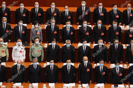 Delegates stand during the opening session of China's National People's Congress (NPC) at the Great Hall of the People in Beijing, China, 22 May 2020. China held the Chinese People's Political Consultative Conference (CPPCC) on 21 May and will hold the National People's Congress (NPC) on 22 May, after the two major political meetings initially planned to be held in March 2020 were postponed amid the ongoing coronavirus COVID-19 pandemic.