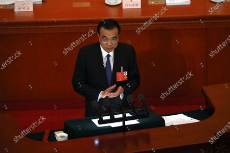 Chinese Premier Li Keqiang delivers the government work report during the opening session of China's National People's Congress (NPC) at the Great Hall of the People in Beijing, China, 22 May 2020. China held the Chinese People's Political Consultative Conference (CPPCC) on 21 May and will hold the National People's Congress (NPC) on 22 May, after the two major political meetings initially planned to be held in March 2020 were postponed amid the ongoing coronavirus COVID-19 pandemic.