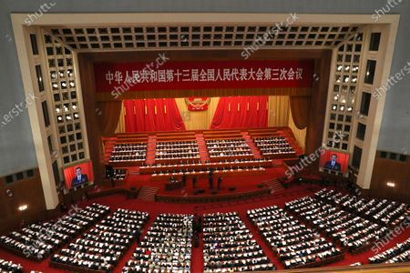 Stock Image of Chinese Premier Li Keqiang (C-L) delivers the government work report during the opening session of China's National People's Congress (NPC) at the Great Hall of the People in Beijing, China, 22 May 2020. China held the Chinese People's Political Consultative Conference (CPPCC) on 21 May and will hold the National People's Congress (NPC) on 22 May, after the two major political meetings initially planned to be held in March 2020 were postponed amid the ongoing coronavirus COVID-19 pandemic.