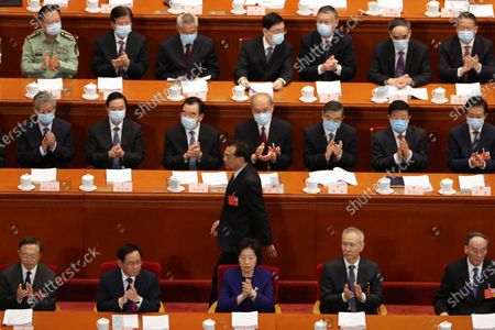 Stock Picture of Delegates applaud as Chinese Premier Li Keqiang (C, standing) prepares to speak during the opening session of China's National People's Congress (NPC) at the Great Hall of the People in Beijing, China, 22 May 2020. China held the Chinese People's Political Consultative Conference (CPPCC) on 21 May and will hold the National People's Congress (NPC) on 22 May, after the two major political meetings initially planned to be held in March 2020 were postponed amid the ongoing coronavirus COVID-19 pandemic.