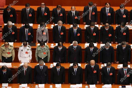 Stock Photo of Delegates bow their heads during the opening session of China's National People's Congress (NPC) at the Great Hall of the People in Beijing, China, 22 May 2020. China held the Chinese People's Political Consultative Conference (CPPCC) on 21 May and will hold the National People's Congress (NPC) on 22 May, after the two major political meetings initially planned to be held in March 2020 were postponed amid the ongoing coronavirus COVID-19 pandemic.
