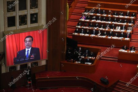 A video screen shows Chinese Premier Li Keqiang as he delivers the government work report during the opening session of China's National People's Congress (NPC) at the Great Hall of the People in Beijing, China, 22 May 2020. China held the Chinese People's Political Consultative Conference (CPPCC) on 21 May and will hold the National People's Congress (NPC) on 22 May, after the two major political meetings initially planned to be held in March 2020 were postponed amid the ongoing coronavirus COVID-19 pandemic.