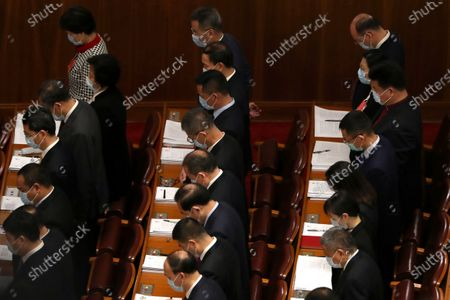 Delegates bow their heads during the opening session of China's National People's Congress (NPC) at the Great Hall of the People in Beijing, China, 22 May 2020. China held the Chinese People's Political Consultative Conference (CPPCC) on 21 May and will hold the National People's Congress (NPC) on 22 May, after the two major political meetings initially planned to be held in March 2020 were postponed amid the ongoing coronavirus COVID-19 pandemic.