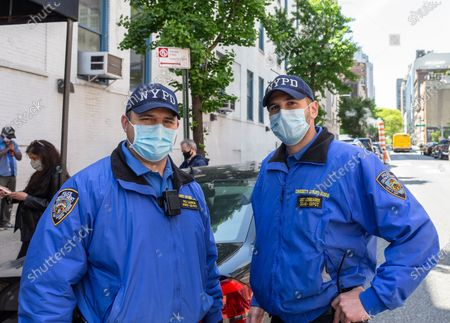 Police officers Larkin and Lombardi provide security for Mayor Bill de Blasio and First Lady Chirlane McCray donation of blood during COVID-19 pandemic at New York Blood Center on 67th street