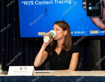 Secretary to Governor Melissa DeRosa drinks Starbucks coffee during Andrew Cuomo announcement and media briefing on COVID-19 pandemic at office on 3rd Avenue