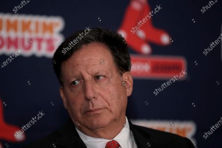 Boston Red Sox baseball team chairman Tom Werner attends a news conference at Fenway Park, in Boston. The Premier League trophy should have been in Tom Werner's hands by now. This week should have featured a victory parade through the streets of Liverpool. Instead, Liverpool's chairman is analysing the health procedures required just to ensure it is safe for his team to train together again during the coronavirus pandemic