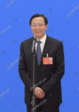 Stock Image of Minister of Agriculture and Rural Affairs Han Changfu is interviewed via video link after the opening meeting of the third session of the 13th National People's Congress (NPC) in Beijing, capital of China, May 22, 2020.