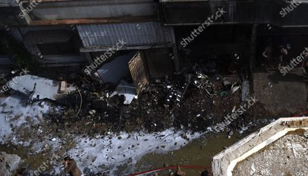 Wreckage of the passenger plane of state run Pakistan International Airlines, at the scene after crashed on a residential colony, in Karachi, Pakistan, 22 May 2020. A PIA Airbus A-320 flight from Lahore to Karachi carrying some 107 passengers and crew, crashed while landing in Karachi on 22 May.
