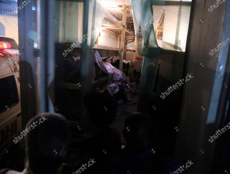 Bodies of the victims of a plane crash are shifted to a mobile mortuary unit after the passenger plane of state run Pakistan International Airlines, crashed on a residential colony, in Karachi, Pakistan, 22 May 2020. A Pakistan International Airlines passenger flight with over 100 people on board crashed on 22 May as it was about to land near a residential area close to the airport in the port city of Karachi, a civil aviation official said.