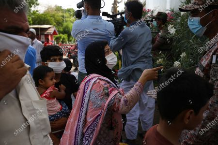 Relatives of the victims of a state run Pakistan International Airlines plane crash arrives at a hospital in Karachi, Pakistan, 22 May 2020. A PIA Airbus A-320 flight from Lahore to Karachi carrying some 107 passengers and crew, crashed while landing in Karachi on 22 May.