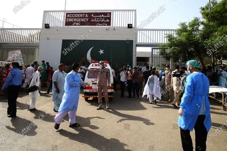 Pakistani security officials secure the premisis of Jinnah Hospital where victims of plane crash are brought in Karachi, Pakistan, 22 May 2020. A PIA Airbus A-320 flight from Lahore to Karachi carrying some 107 passengers and crew, crashed while landing in Karachi on 22 May.