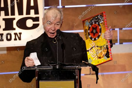 """John Prine accepting the Album of the Year award at the Americana Honors & Awards show in Nashville, Tenn. The Recording Academy has released a new recording of John Prine's """"Angel From Montgomery"""" with proceeds going to support the MusiCares COVID-19 Relief Fund. Prine died in April at age 73 from complications associated with the new coronavirus"""