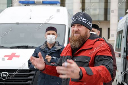 On, Chechnya's regional leader Ramzan Kadyrov speaks to journalists as he presens new ambulance vehicles in Grozny, Russia. Russian state news agencies reported Thursday May 21, 2020, that Ramzan Kadyrov, leader of Russia's southern region of Chechnya, had been transported to a Moscow hospital with suspected coronavirus