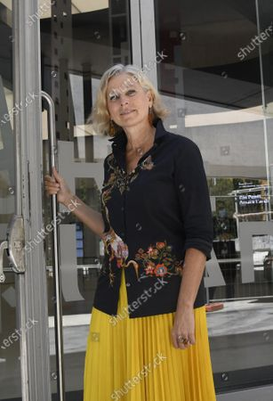 Stock Picture of The Maxxi Foundation president Giovanna Melandri on the museum door opens symbolically to visitors