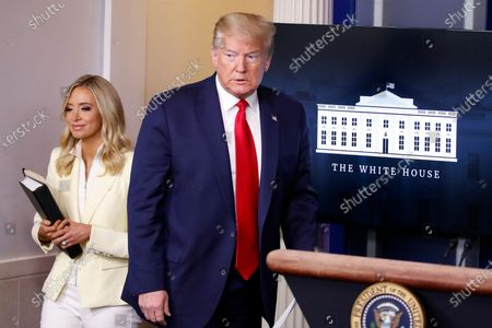 President Donald Trump arrives to speak with reporters about the coronavirus in the James Brady Briefing Room of the White House, in Washington with White House press secretary Kayleigh McEnany