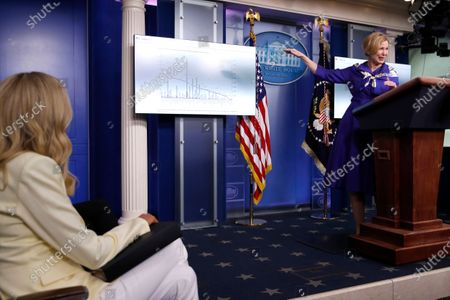 Dr. Deborah Birx, White House coronavirus response coordinator, speaks with reporters about the coronavirus in the James Brady Briefing Room of the White House, in Washington, as White House press secretary Kayleigh McEnany, left, listens