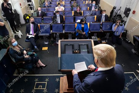 President Donald Trump arrives to speak with reporters about the coronavirus in the James Brady Press Briefing Room of the White House, in Washington