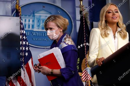 Dr. Deborah Birx, White House coronavirus response coordinator, leaves after speaking with reporters about the coronavirus in the James Brady Briefing Room of the White House, in Washington, as White House press secretary Kayleigh McEnany talks at the podium