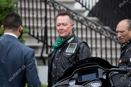 """Actor Robert Patrick, center, stands before President Donald Trump speaks during a """"Rolling to Remember Ceremony,"""" to honor the nation's veterans and POW/MIA, from the Truman Balcony of the White House, in Washington"""