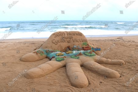 A view of a sand sculpture made by Indian sand artist Sudarsan Pattnaik on the theme of Cyclone Amphan with a message, 'Join hands, Help Cyclone victims,' at Puri beach, in Odisha, India, 22 May 2020. Amphan, the first tropical cyclone of the 2020 season in the North Indian basin, made landfall on 20 May 2020. The storm slammed ashore near the border of eastern India and Bangladesh, delivering substantial storm surge to coastal areas. The Indian states of Odisha and West Bengal were heavily affected by Amphlan, with 80 people reportedly killed in Bengal and the state capital Kolkata bearing heavy damages.