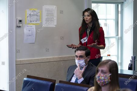 One America News Network reporter Chanel Rion asks a question of White House press secretary Kayleigh McEnany as she speaks with reporters about the coronavirus in the James Brady Press Briefing Room of the White House, in Washington
