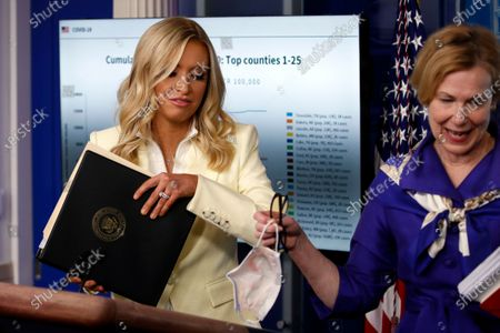 White House press secretary Kayleigh McEnany moves to the podium after Dr. Deborah Birx, White House coronavirus response coordinator, spoke with reporters about the coronavirus in the James Brady Briefing Room of the White House, in Washington
